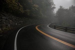 Mountain wet asphalt road curve