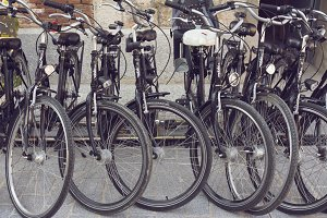 Station of urban Black bicycles for
