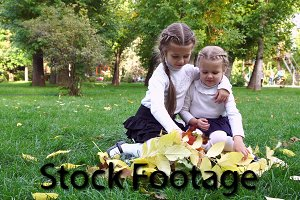 Two sisters in an autumn park