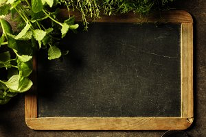 Blank chalkboard with herbs