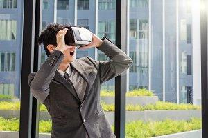 Asian Man wearing virtual reality