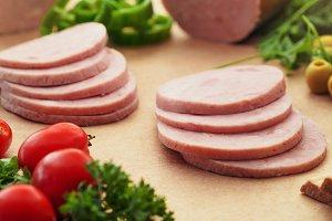 Cutted Ham Sausage on kraft paper background