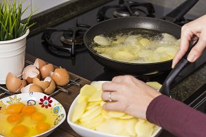 Woman cooking an omelette