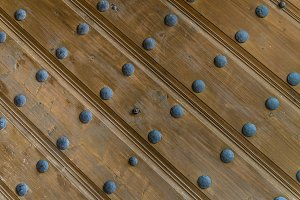 Wood boards with iron forged rivets