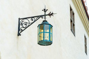 Antique lantern on the castle wall