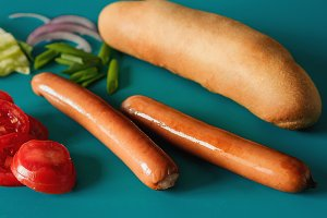 two grilled sausages with vegetables, ingredients for hotdog