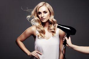 Elegant blond woman in a studio