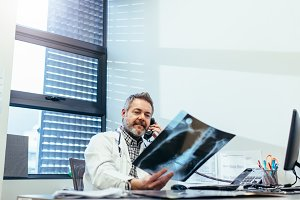 Doctor examining x-ray and talking
