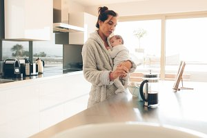 Woman with her son in kitchen