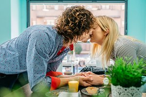 Couple kissing in a cafe