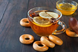 Cup of tea with lemon and bagels