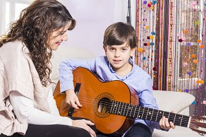 Mother and son playing guitar