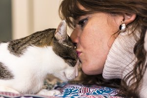 Happy woman kisses her cat