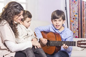 Happy family playing guitar