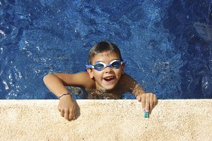 Boy with glasses in a swimming pool