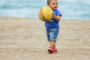baby playing on the beach