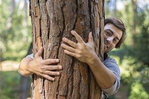 Man hugging a big tree