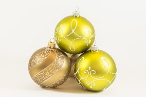 Three golden christmas balls