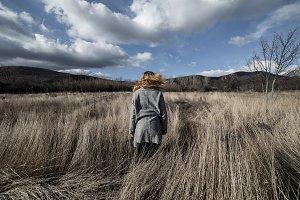 Woman posing in dried field