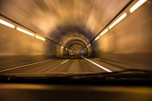 Car driving through tunnel