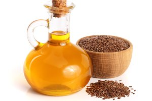 linseed oil with flax seeds isolated on white background
