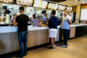 Blurred view of Interior typical fast food restaurant