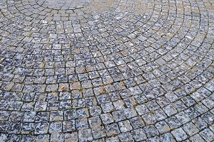 Abstract background of old cobblestone pavement.