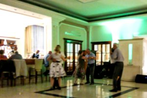 Blured view of traditional evening dances in lobby of resort spa hotel