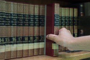closeup hand selecting book
