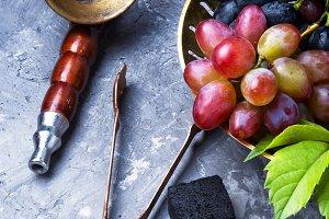 Arabic smoking hookah with grapes