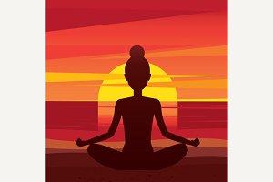Woman sitting in yoga pose padmasana on the beach
