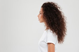 Pretty curly woman posing in profile