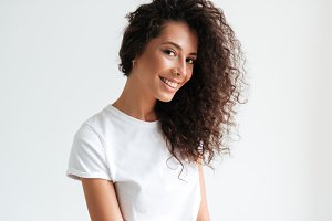 Portrait of an attractive smiling girl looking at camera