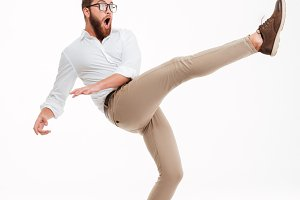 Handsome young bearded man jumping