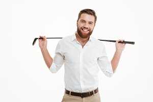 Cheerful young bearded man holding golfstick