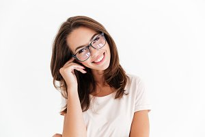 Pretty smiling woman in eyeglasses looking at the camera