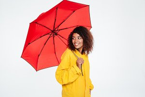 Side view of Smiling african woman in raincoat posing