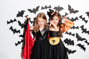 Couple of two scary little girls dressed in halloween costumes