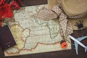 Top view Halloween & travel items.