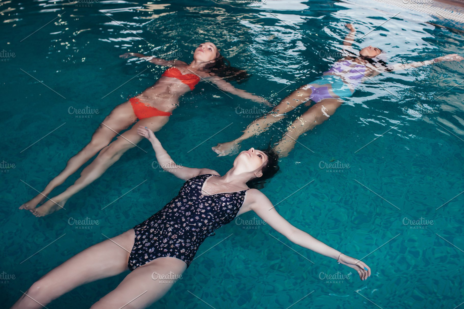 Young slim women training in swimming pool swimming on back ~ People ...