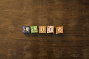Child in wooden blocks