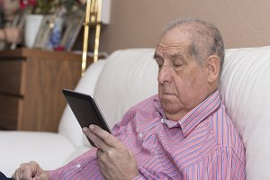 mature man using his digital tablet