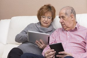 Happy senior couple with tablet