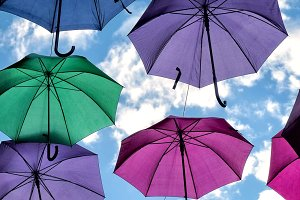 Colorful umbrellas over the blue sky