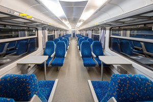 Empty train interior with blue chairs
