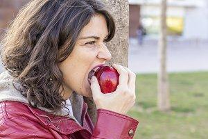 Woman biting an apple