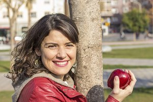 Beautiful woman with a red apple