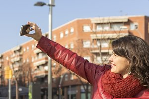 Smiling woman taking selfie