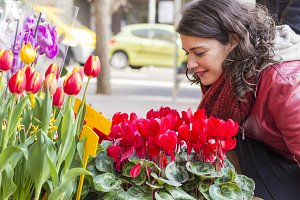 Beautiful woman buying flowers