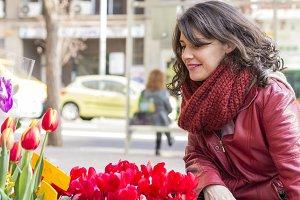 Beautiful woman buying flowers